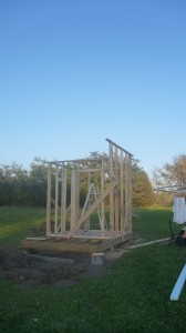Using a hybrid pole barn / regular wall I built an 8x8 frame for my shed.