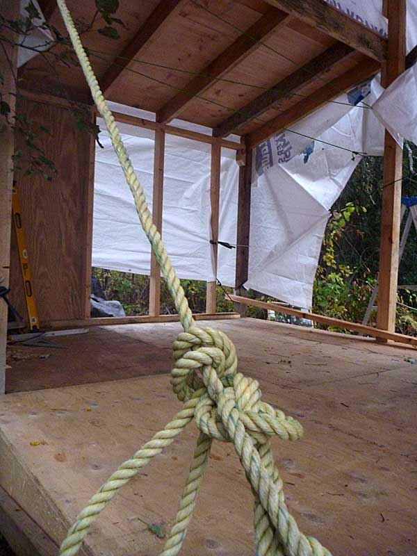 I tied the tarp down with a variety of ropes and bungie cords. Looks pretty, er, spider like?