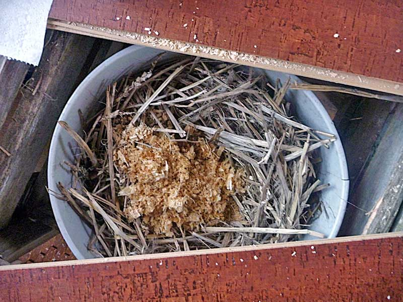 "Applied to a composting toilet bucket. Note the ""nest"" of straw used for material containment in order to keep the bucket cleaner."