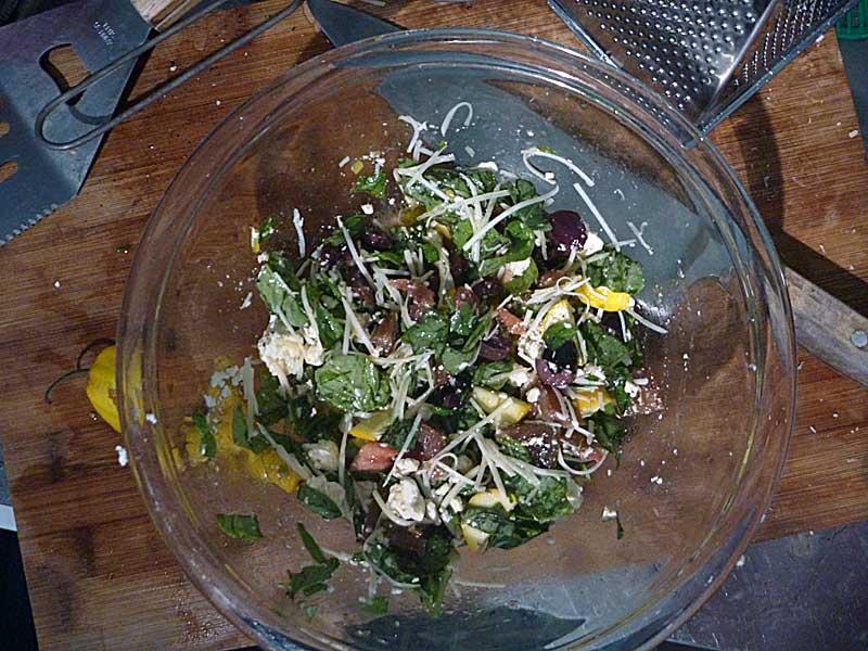Summer pesto. Basil leaves, black olives, feta, hot peppers, shredded parmigiana, olive oil.
