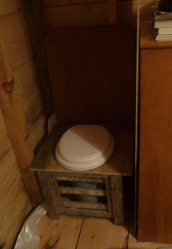 Testing bokashi in an indoor straw bucket toilet.