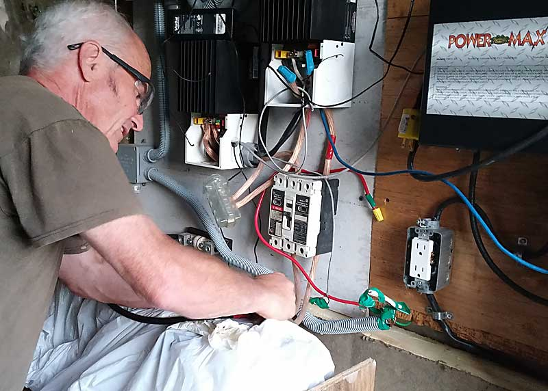 A picture of concentration as I begin wiring up the batteries.